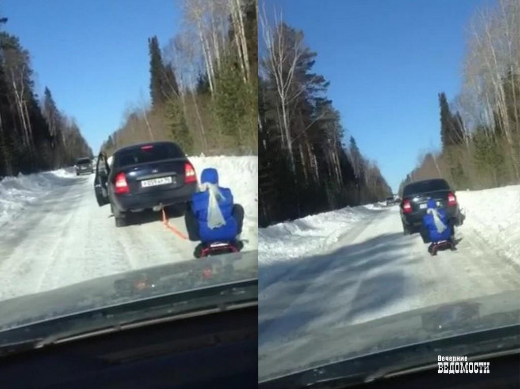 ГИБДД наказала свердловчанку, катавшую внука назацепленном замашину снегокате